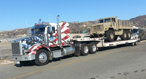 gallery- lowbed hauling hummer tank