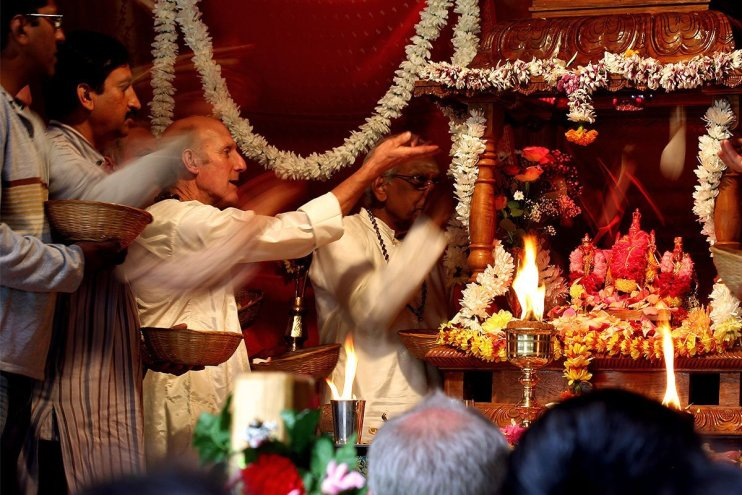 Swamis, monks and devotees offer flower petals to Lord Subramanium at a festival at Skanda Vale