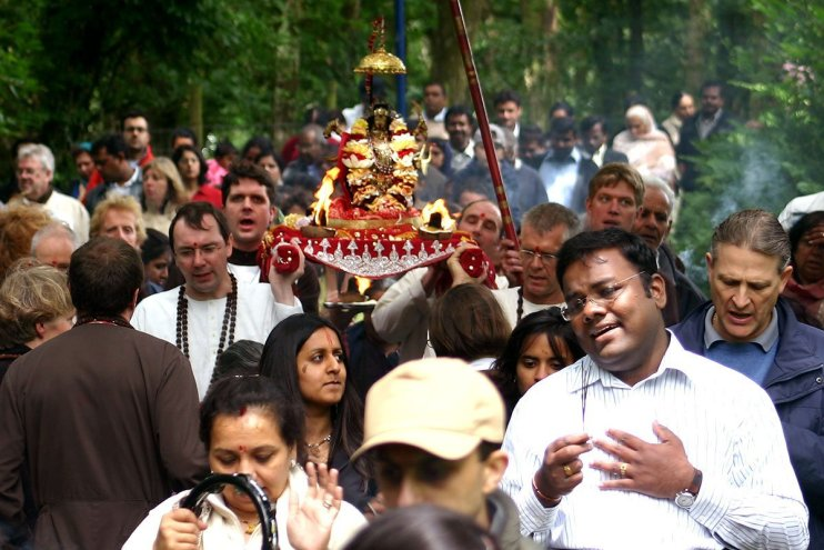 Devotees in procession with Maha Kali - singing, praying and dancing