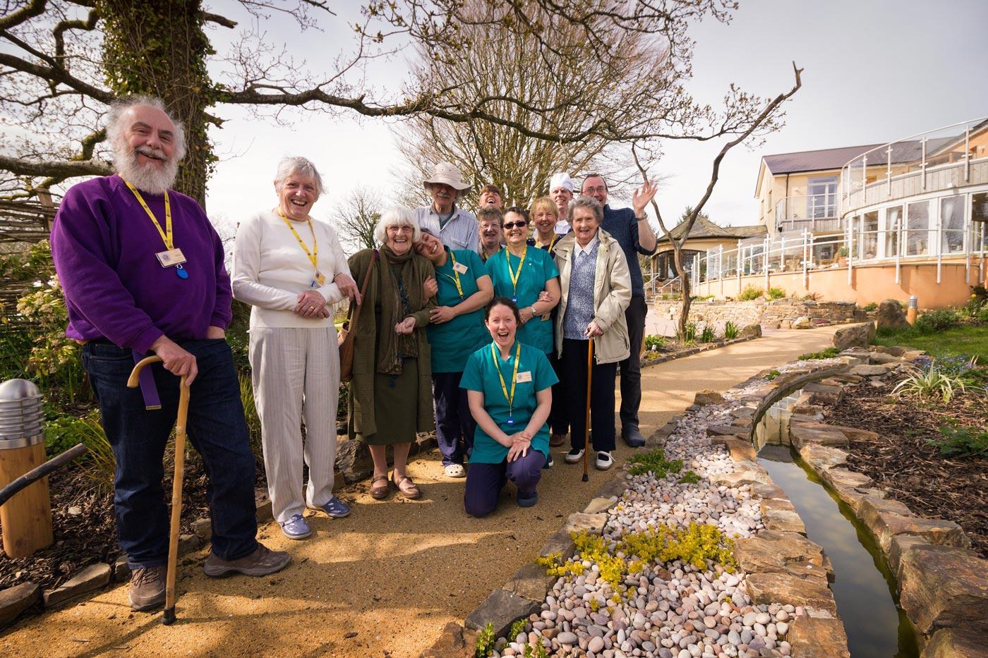 Staff, patients and volunteers in the Skanda Vale Hospice garden