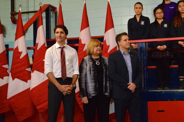 Prime Minister Justin Trudeau, Minister of Employment, MaryAnn Mihychuck, and Parliamentary Assistant for the Prime Minister of Youth, Peter Schiefke, at Dovercourt Boys & Girls Club in Toronto on Feb. 12.