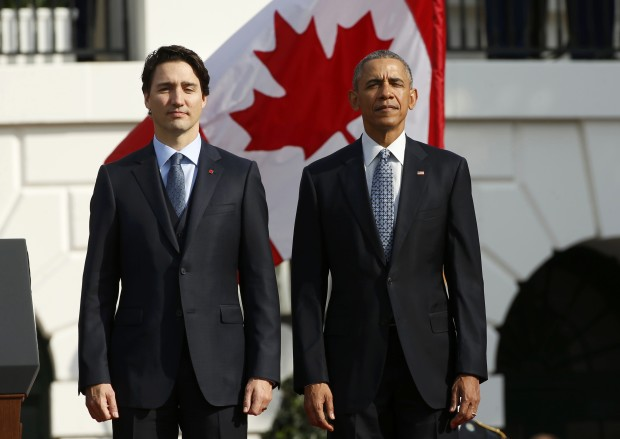 U.S. President Barack Obama (R) and Canadian Prime Minister Justin Trudeau take part in an arrival ceremony for Trudeau at the White House in Washington March 10, 2016. REUTERS/Kevin Lamarque