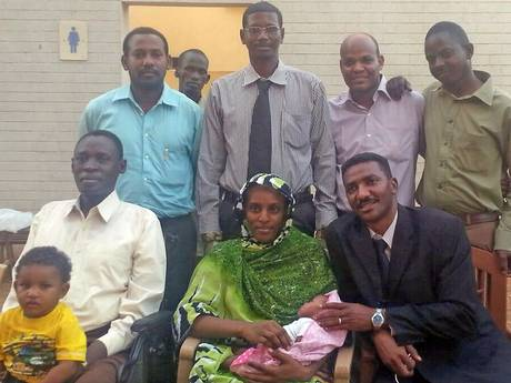 Meriam Ibrahim with her husband Daniel Wani (left), and two sons, after her release (Getty)