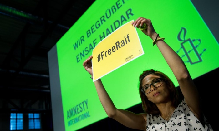 Ensaf Haidar, the wife of jailed Saudi blogger Raif Badawi, at the annual meeting of the German section of Amnesty International in Dresden, Germany on 23 May 2015. Photograph: Arno Burgi/dpa/Corbis