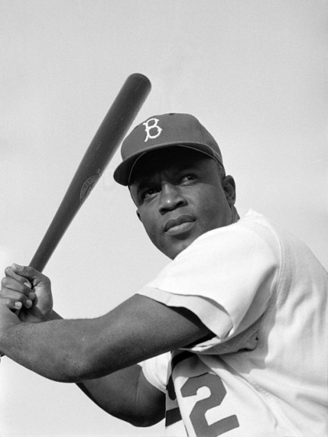 Jackie Robinson playing for the Brooklyn Dodgers in 1954. Copyright held by United State Library of Congress, freely licensed.