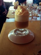 Italy's Bombardino is a hot Alpine drink comprised of an egg nog-like liqueur, whiskey or brandy and whipped cream.
