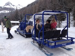 Guest get to enjoy the views while they're transported via snowmobile to their accommodations at the Mascognaz.