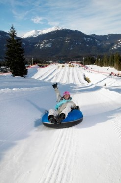 Whistler Blackcomb's Coca-Cola Tube Park's lanes are 1,000 feet long and are accessed via a conveyor belt so bagging run after run is easy breezy. Whistler, British Columbia, Canada. pc: Destination BC/Randy Lincks