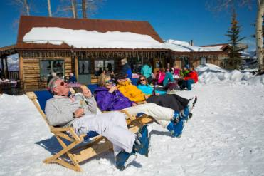 Enjoy the spring sun and a beverage or snack of choice at Snowmass' Lynn Britt Cabin. | Photo: Asen Snowmass