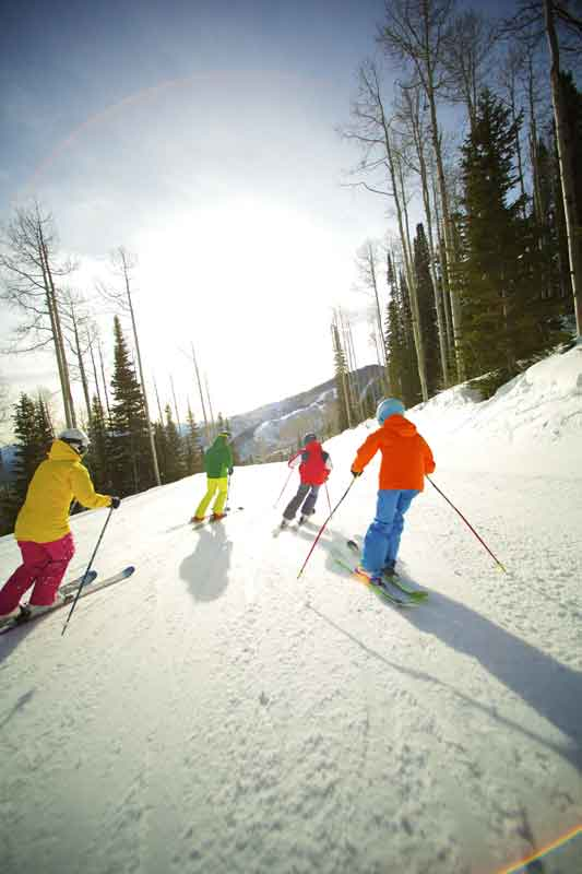 A family skis together on the Canyons Village side of Park City Mountain.
