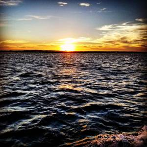Beautiful sunset from the boat in Little River inlet.        …