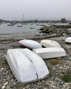 Scattered Skiffs  The morning fog lifted, revealing the scattered skiffs through…