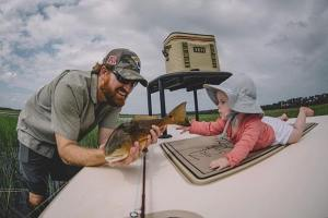Taking baby fishing.     photo: …