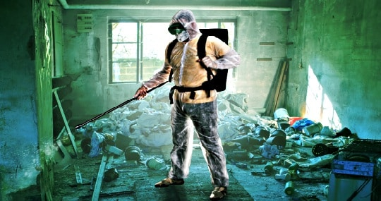 Man In Tyvek Suit Cleaning Up A Contaminated Room