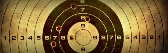 Gun Target Showing Reloading Accuracy