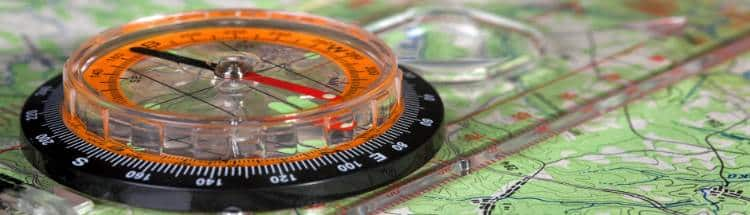 Close up photos of compass on the map