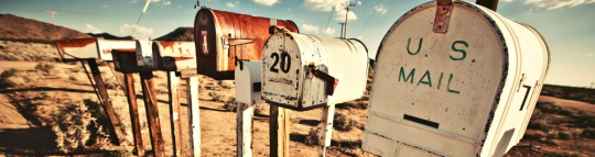 row of old rural mailboxes