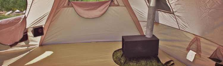 wall tent stove in canvas tent