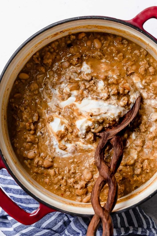 A delicious, creamy White Bean Turkey Chili recipe is made with canned white beans, ground turkey, aromatics and spices – no tomatoes!