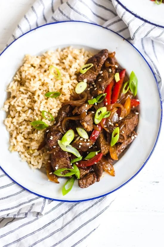 Pepper steak is quick, easy and perfect to whip up any night of the week. Strips of beef and bell peppers are stir fried in a wok to create a delicious main dish, ready in no time! I love it with brown rice, but cauliflower rice would also be great on the side.