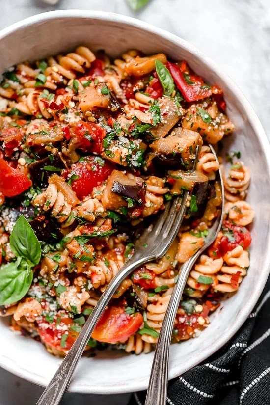 This simple Eggplant and Tomato Sauce is delicious, made with diced eggplant stewed in tomatoes and garlic. I love it served over pasta but it's also great over zucchini noodles, polenta or as a side dish on it's own.