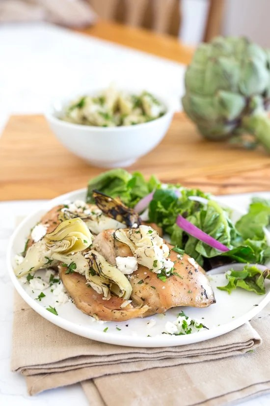 Chicken Thighs with Artichoke Hearts and Feta Cheese is made with just a few ingredients and is ready in less than 30 minutes!