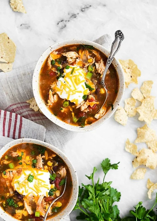 Everything you love about chicken enchiladas... in one big bowl! I love turning classic meals into soups, it's an easy (maybe even lazy) way to make a dish that only dirties one pot!