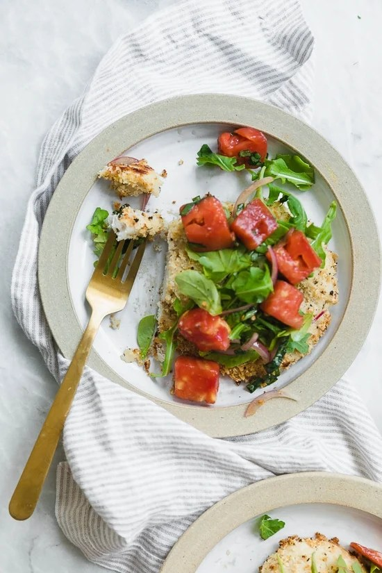 Breaded chicken cutlets, baked in the oven topped with arugula, tomatoes and balsamic. This is my favorite restaurant dish, made healthier!