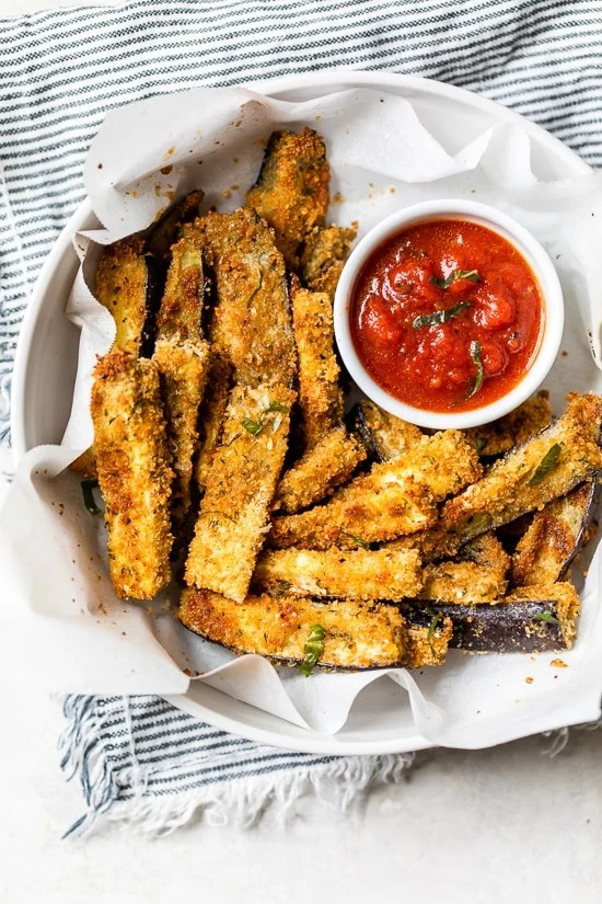 These Baked Eggplant Sticks are breaded with Italian breadcrumbs and Parmesan, baked or air-fried until golden, and served with a quick marinara sauce.