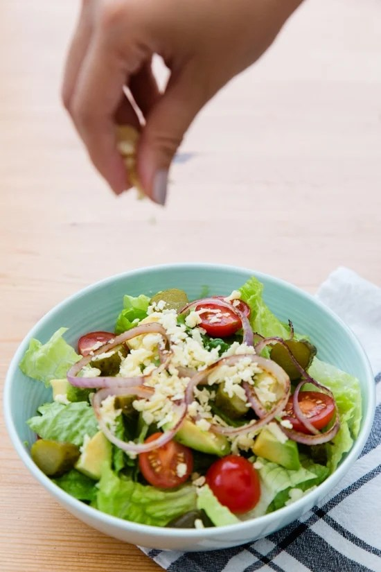 This salad has everything I love about a cheeseburger, sans the bun. Chopped romaine, tomatoes, avocado, pickles and shredded cheese are topped with grilled burgers and red onions and drizzled with a seriously delicious dressing.