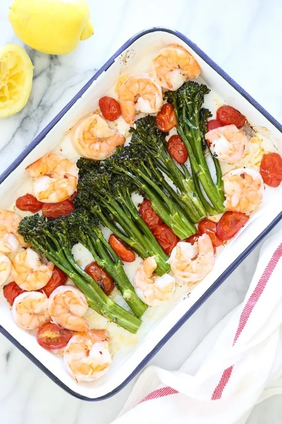 Shrimp, broccoli, and lemon on a sheet pan.