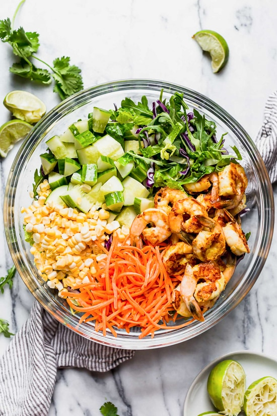 This refreshing Thai-style salad with greens, herbs, veggies and shrimp, all tossed in a delicious cashew dressing, is the perfect one-dish summer dinner.