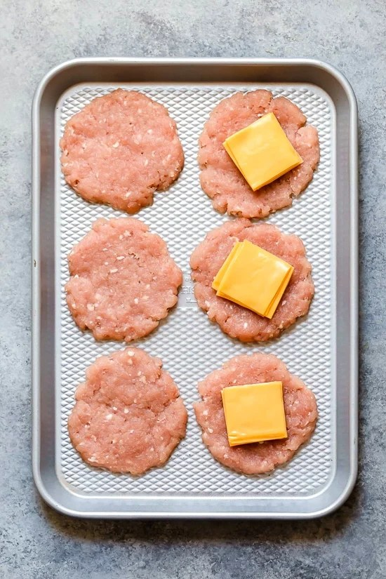 Turkey Burgers Stuffed with cheese are simple and delicious! Made with 2 ingredients not counting salt and pepper.