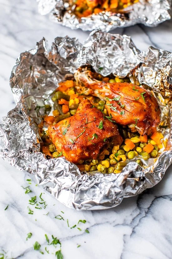 These easy 5-ingredient BBQ Chicken Foil Packets can be baked in the oven or made on the grill! An easy meal-in-one and the best part, easy cleanup!