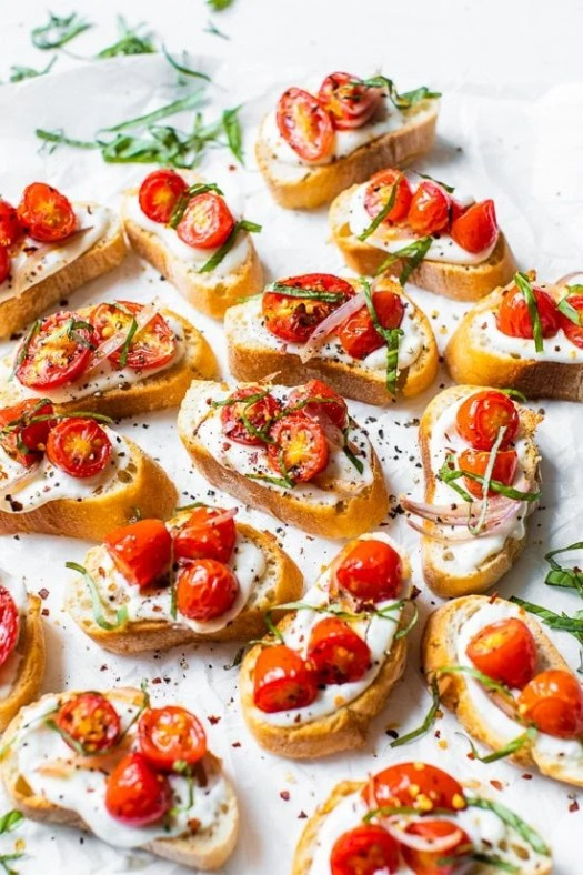 Whipped Ricotta Toast with Roasted Tomatoes on a white background