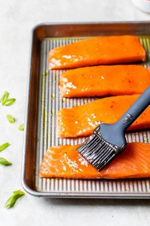 brushing glaze on salmon