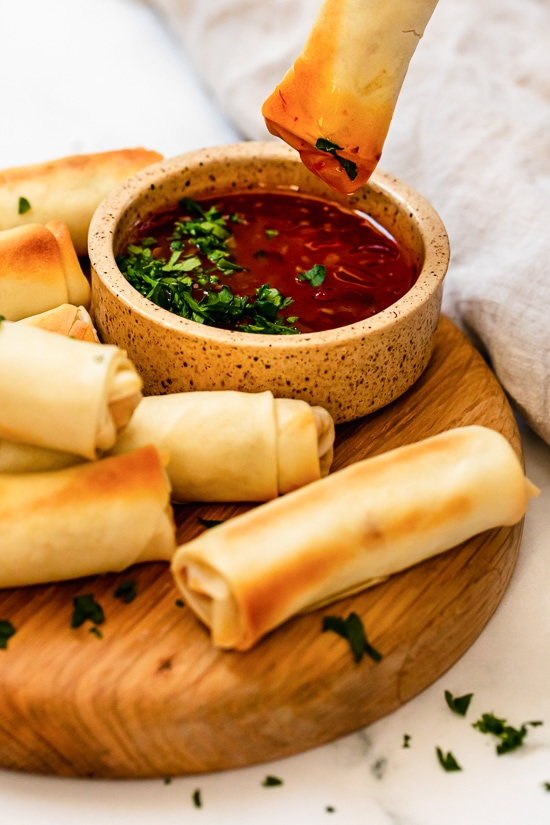 dipping egg rolls in salsa