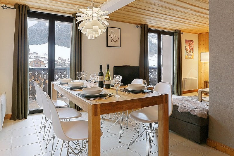 Open plan dining in the mountains at Morzine apartment Petite Ibex