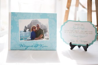 A photo album doubled as a guest book for the guests to sign. The back pages were themed pages that were left blank for guests. Photo courtesy of Nicole Lopez Photography.