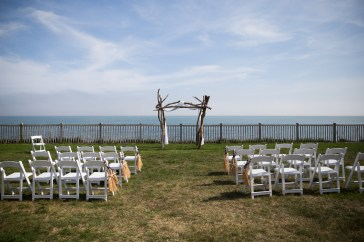 Beautiful driftwood arbor at the Pelham House Resort in Dennisport, Mass. Arbor by Fancy Flowers by Meredith. Photography by Organic Photography.