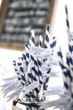 Custom flags by SKO Designs were attached to the paper straws for the mason jars. Photography by Organic Photography.