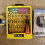 Fio de solda, caixa de ferramentas e velocímetro de bicicleta sem fio