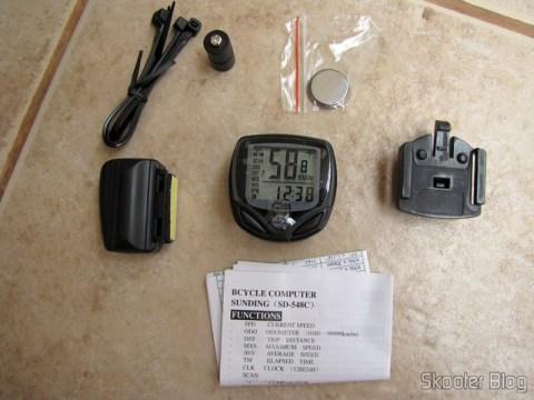 Braçadeiras, magneto, bateria CR2032, tranmissor/sensor, computador, suporte e manual