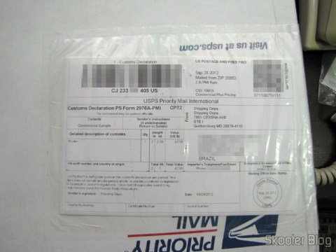 Caixa da USPS com o Roteador Wireless Gigabit 1300Mbps ASUS RT-AC66U (ASUS RT-AC66U 1300 Mbps Gigabit Wireless Router)