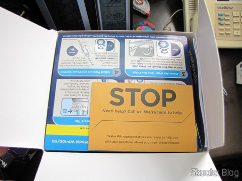 Abrindo a embalagem do Waterpik Ultra Water Flosser