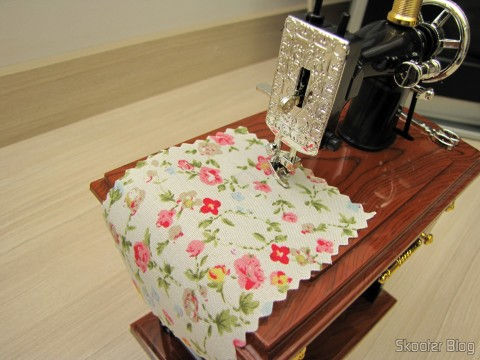 The fabric being sewn on Mini Musical Box Mechanical Old Style Sewing (Vintage Mini Sewing Machine Style Mechanical Music Box)