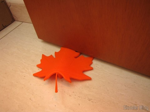 To-Door Style Orange Maple Leaf (Maple Leaf Style Door Stopper Guard - Orange), being used