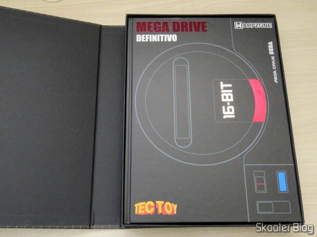Livro Mega Drive Definitivo, dentro de sua caixa.
