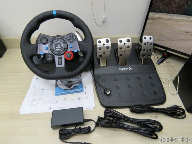 Driving Force Logitech racing wheel G29, with the pedals, source, cables & brochures.