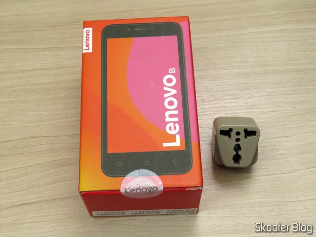 Lenovo Smartphone B Vibe 8 GB and the adapter.